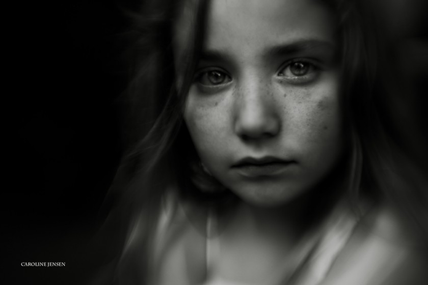 dark and dramatic photo of young girl by Caroline Jensen