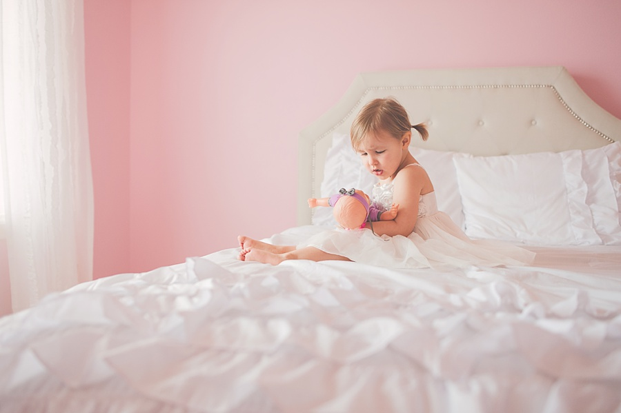 lifestyle pictures of girl on bed in a pink room by Brittany Chandler