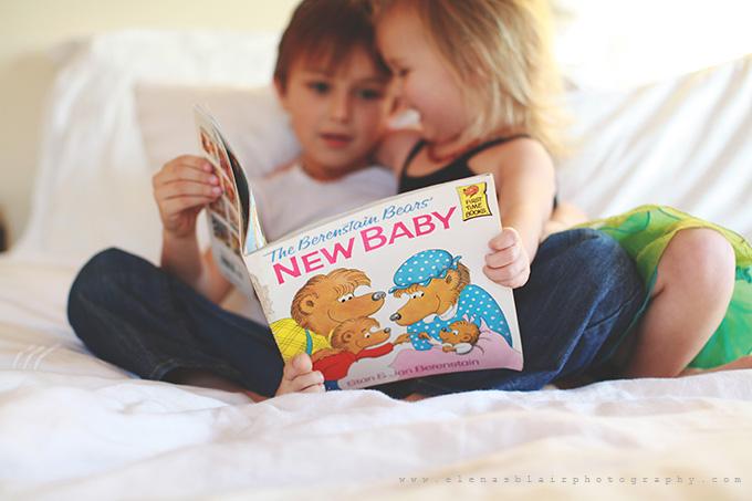 reading a book pregnancy announcement by Elena Blair