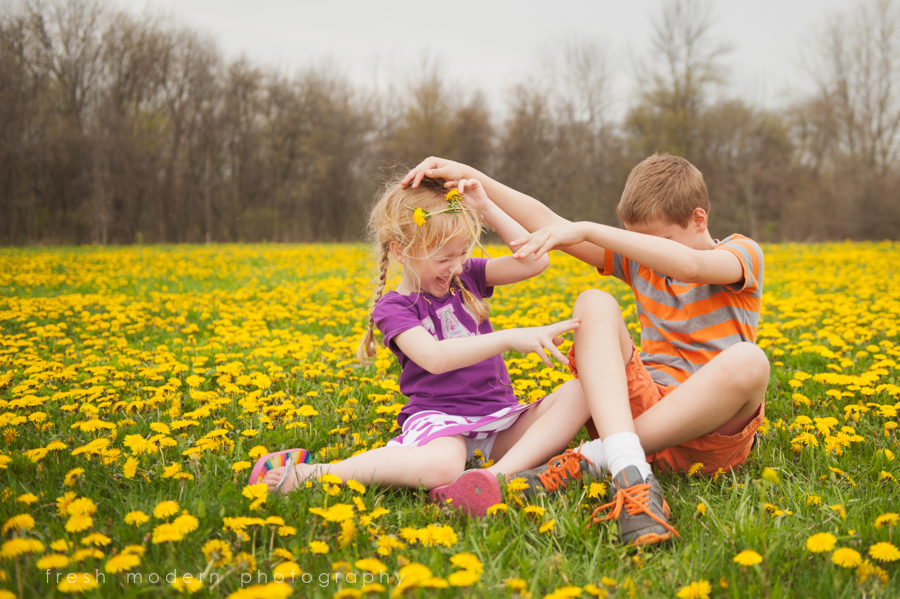 siblings playing in field of flowers picture by Mickie DeVries