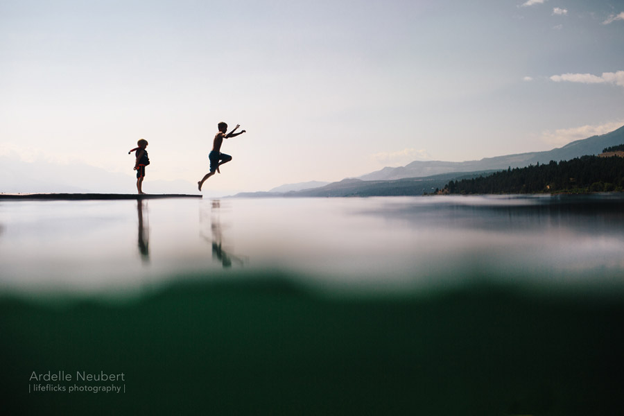 boys jumping into the lake photo by ardelle neubert of lifeflicks photography