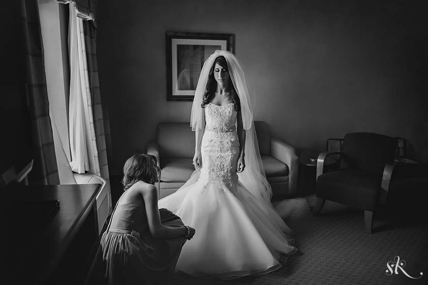 bride getting ready photo by Sarah Kossuch
