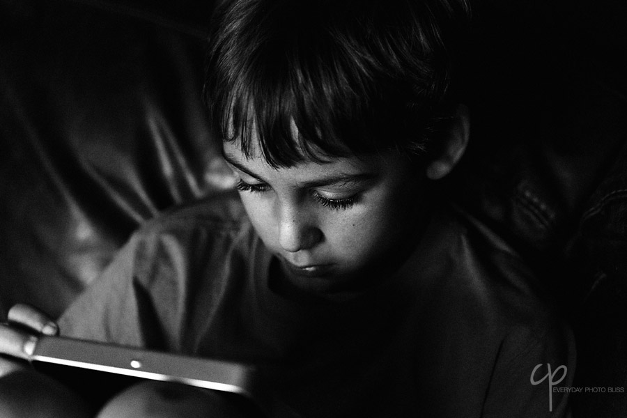 child playing on an electronic device pic by Celeste Pavlik