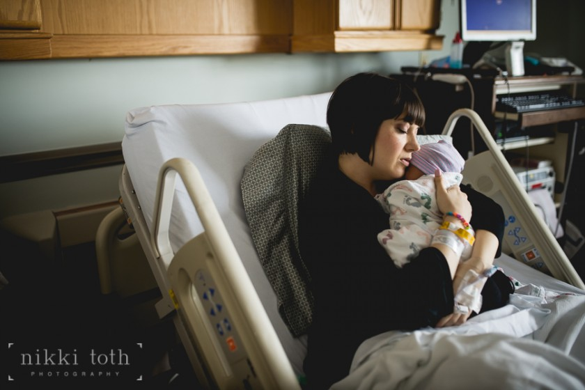 new mom holding baby in hospital photo by Nikki Toth