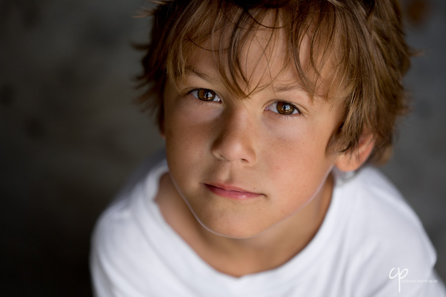 portrait of boy looking at camera by Celeste Pavlik