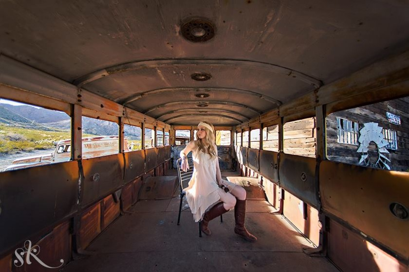 senior sitting on an old empty bus picture by Sarah Kossuch