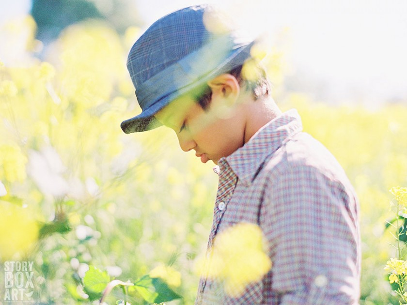 boy in a field of flowers photo by Storybox Art