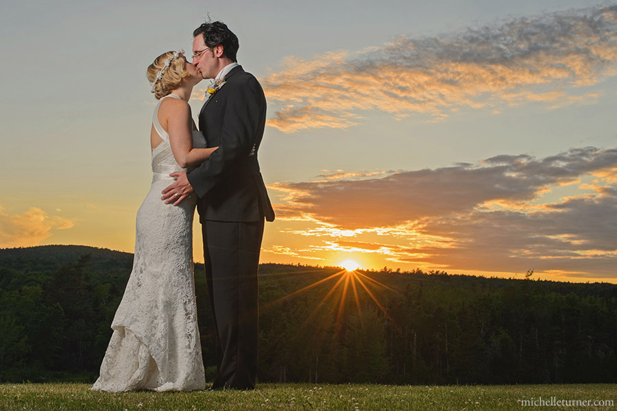 bride and groom kissing with the sunset photo by Michelle Turner