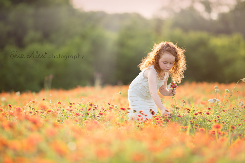 curly haired girl in wildflower field photo by Eliz Alex Photography