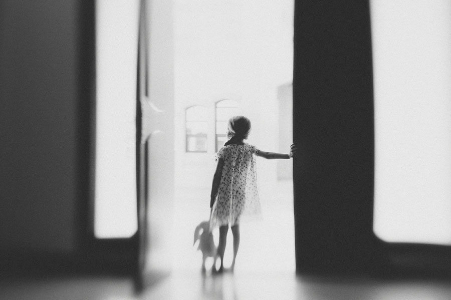 girl standing in a doorway picture by Emma Wood
