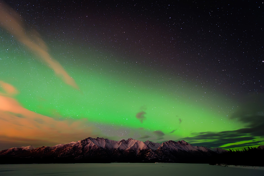 green and orange northern lights in Alaska picture by Christal Houghtelling