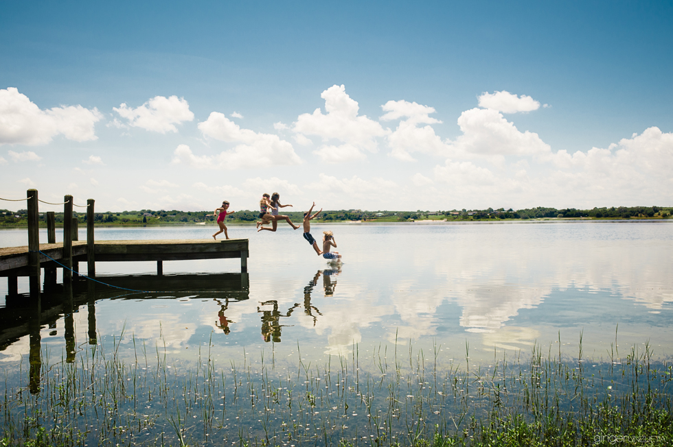 photo of kids jumping off a dock by Florida photographer Ginger Unzueta