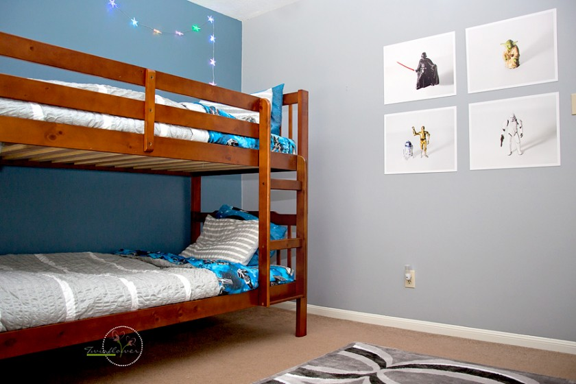 photos of star wars toy pictures hanging on boys bedroom walls