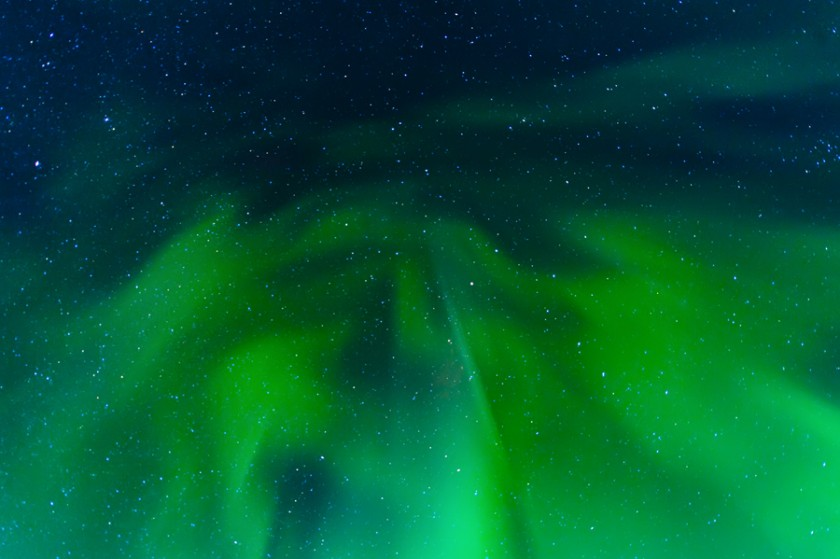swirling green northern lights photo by Christal Houghtelling
