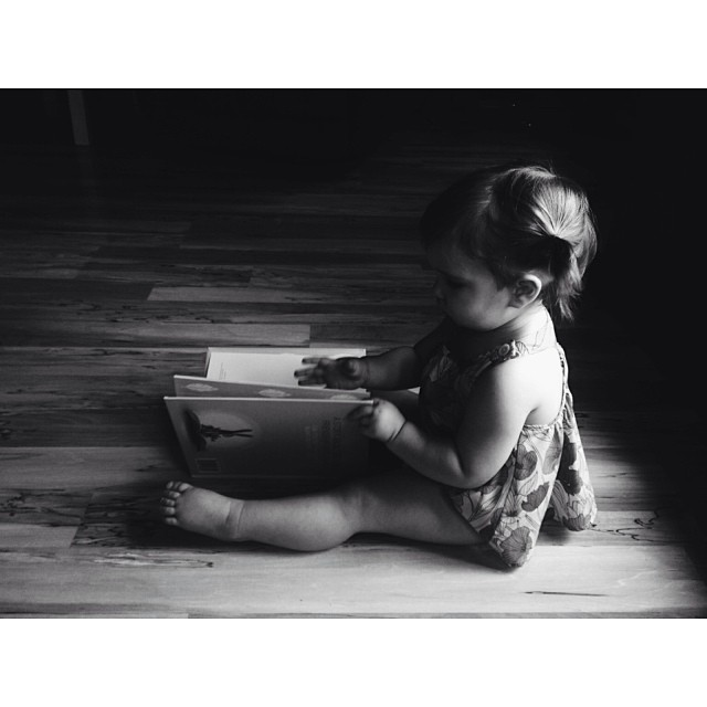 toddler reading book instagram photo by inloveness
