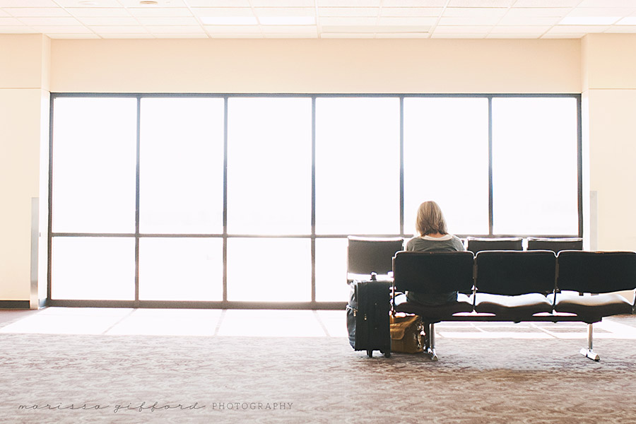 woman sitting in airport photo by Marissa Gifford