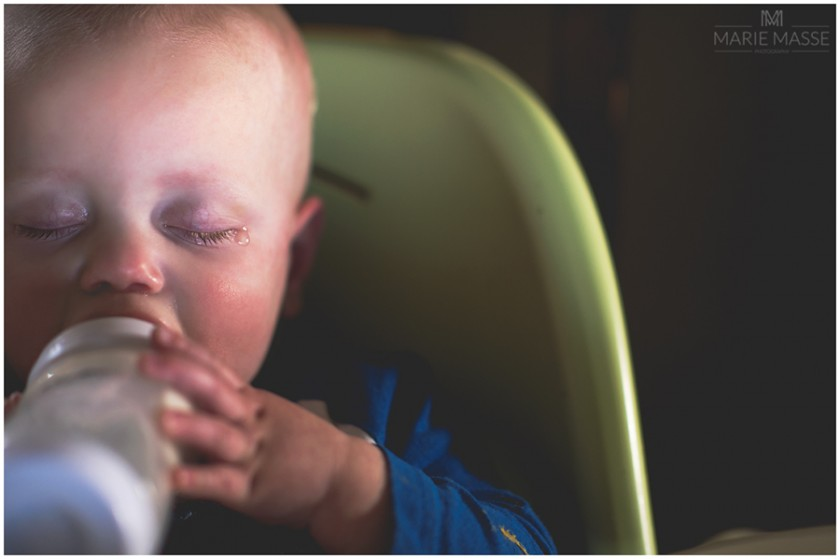 baby drinking bottle picture by Michigan photographer Marie Masse