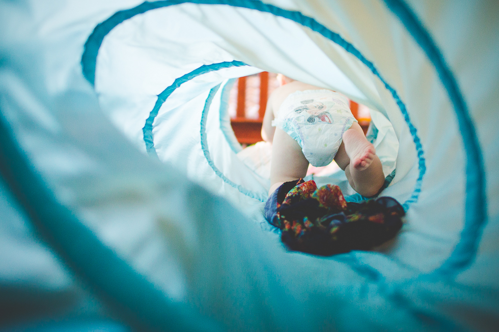 child crawling through tunnel photo by Lissa Chandler