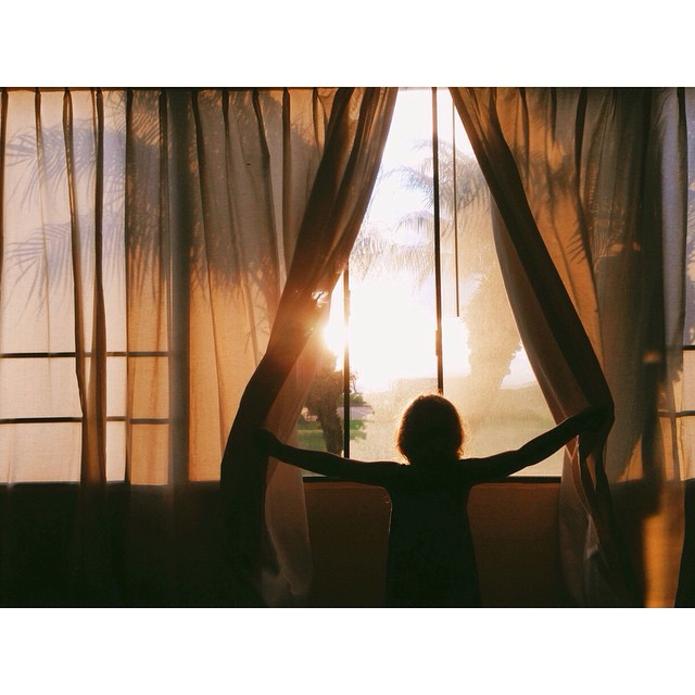 child looking out window instagram picture by ewallis
