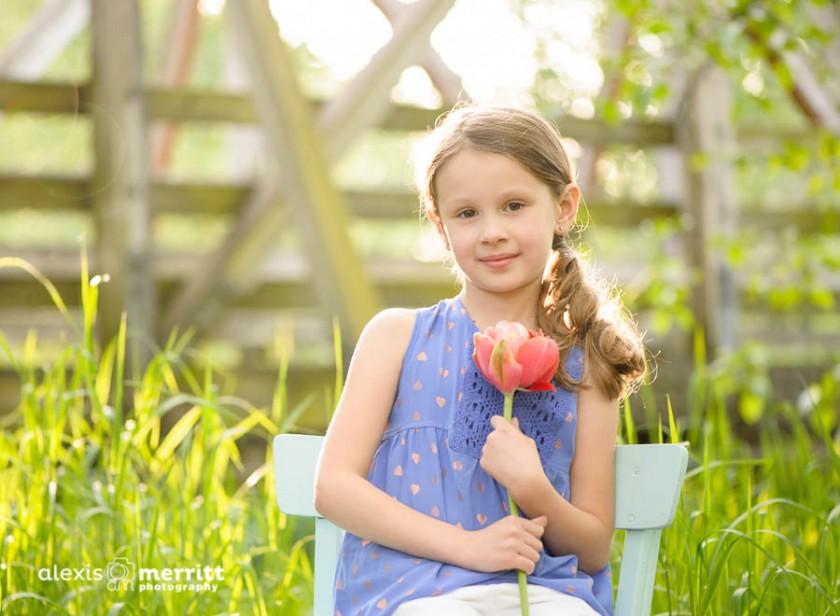 girl holding flower photo by Alexis Merritt