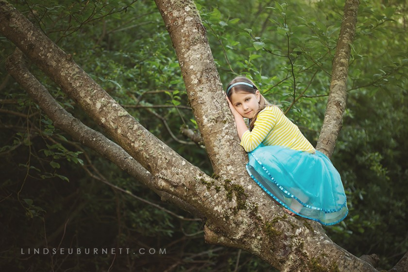 girl in a tree photograph by Lindsey Burnett