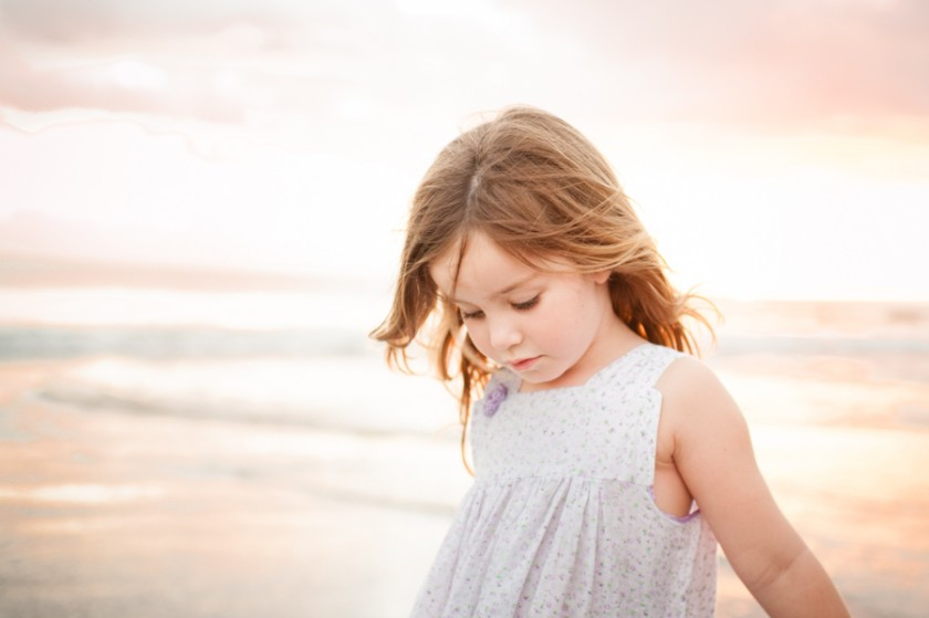 girl on the beach at sunset picture by Sarah Vaughn of Story Lane Photography
