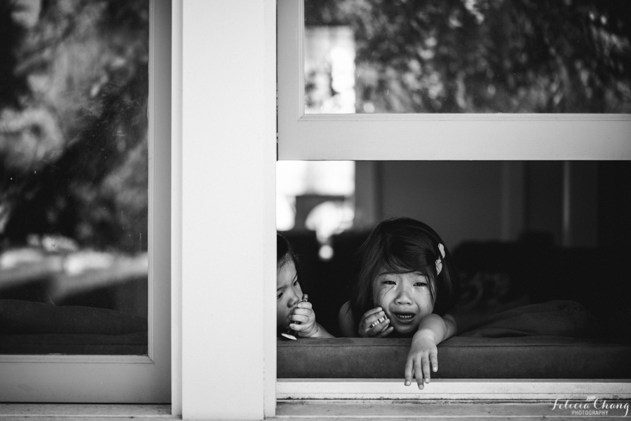 girls looking out window photo by Felicia Chang