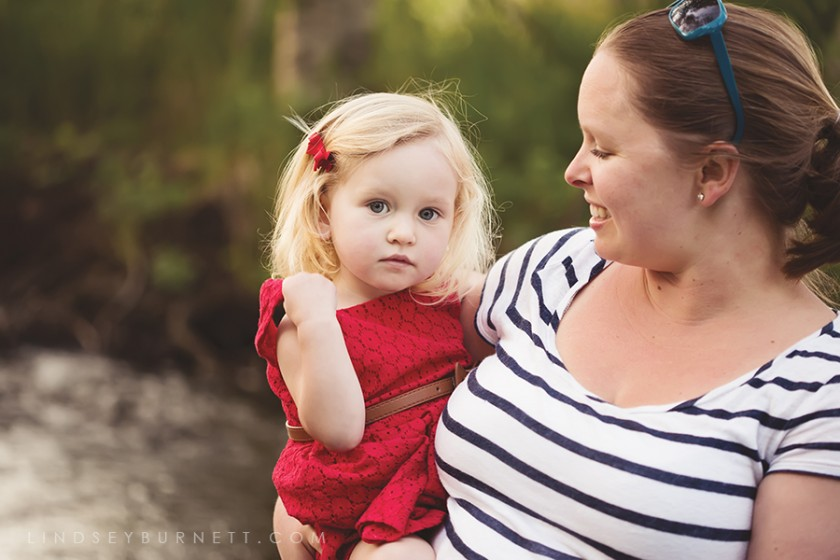 mom holding daughter photo by Lindsey Brunett