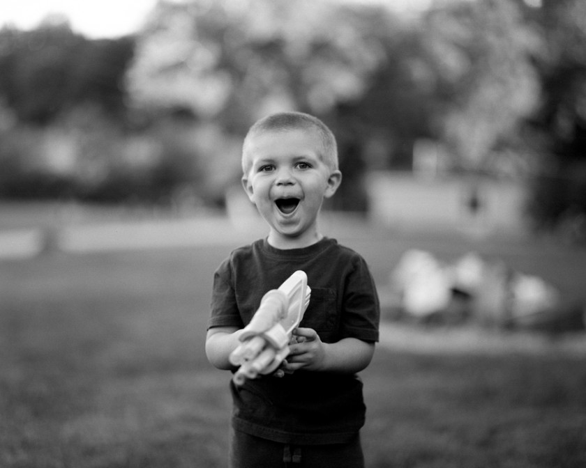 Black and white portrait of boy with toy gun by ohio photograph matt day
