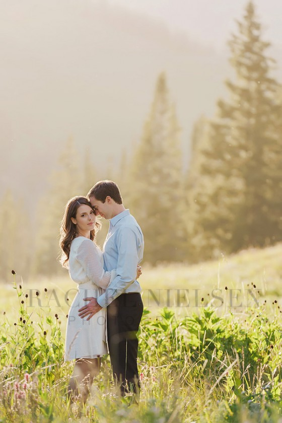 engagement portrait in a sun filled field by Salt Lake City Utah photographer Rachel Nielsen