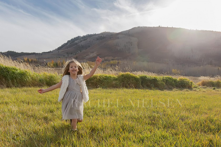 girl running in field pic by Salt Lake City Utah photographer Rachel Nielsen