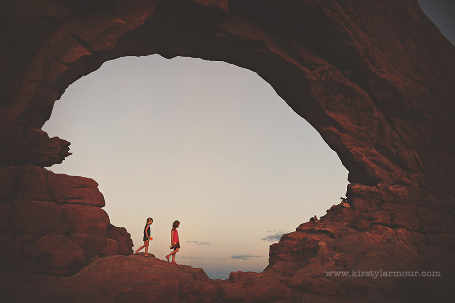 kids walking through arch by Kirsty Larmour