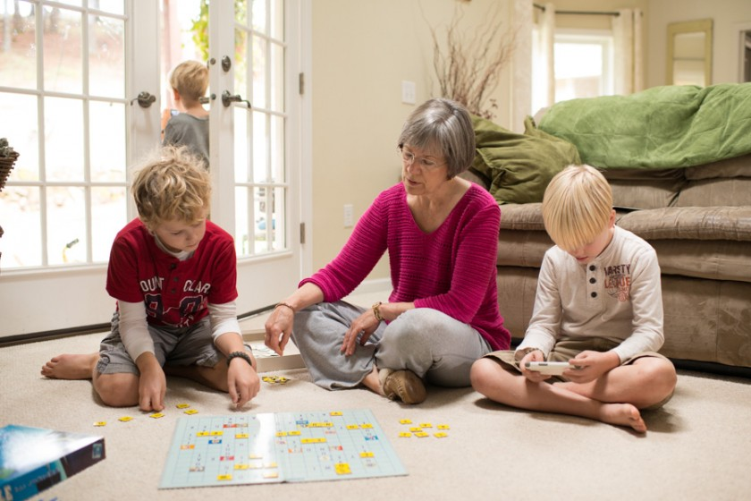 photo of kids playing with their grandma by Lacey Meyers