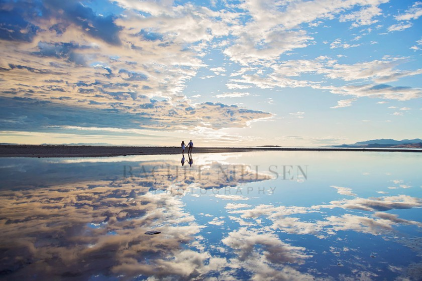 wide angle photo of couple with sky and lake by Salt Lake City Utah photographer Rachel Nielsen