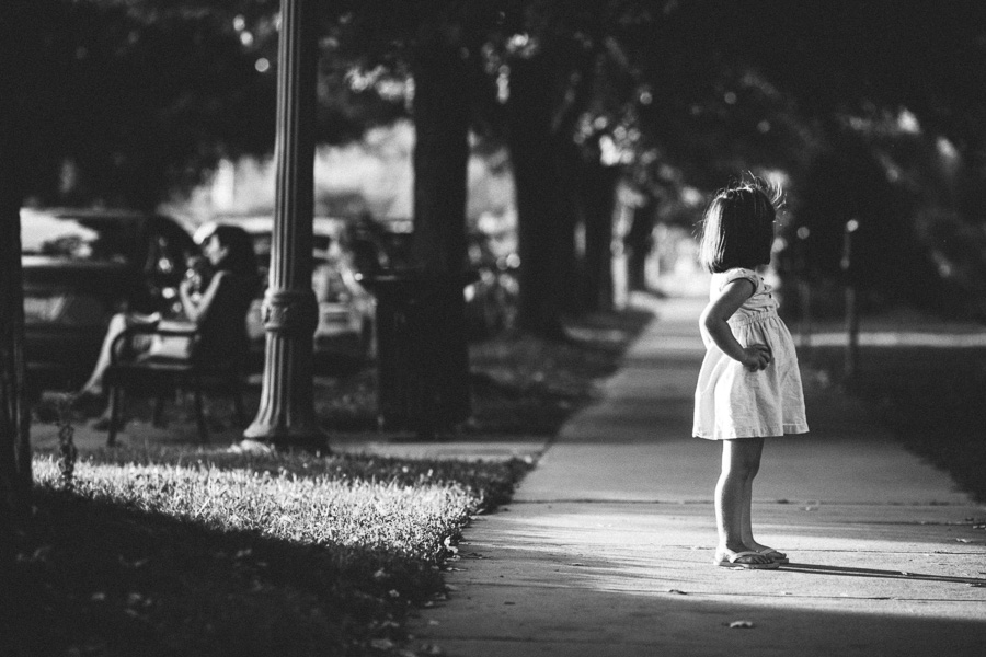black and white photo of girl with hands on hip by Kristy Dooley