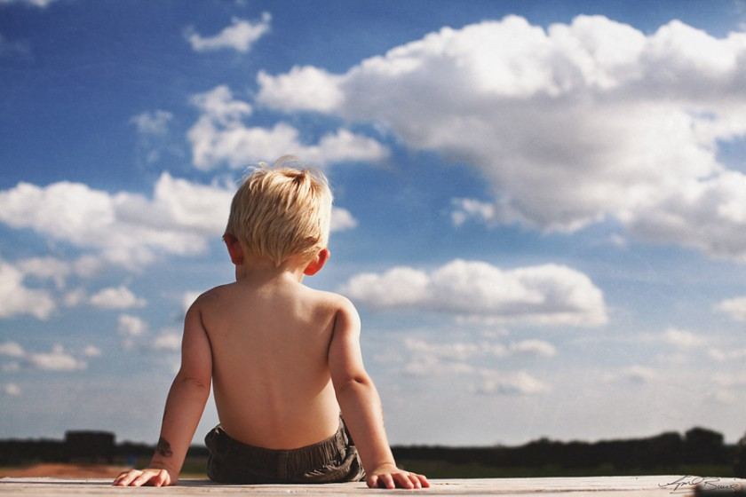 boy sitting in the sun by April Burns 6