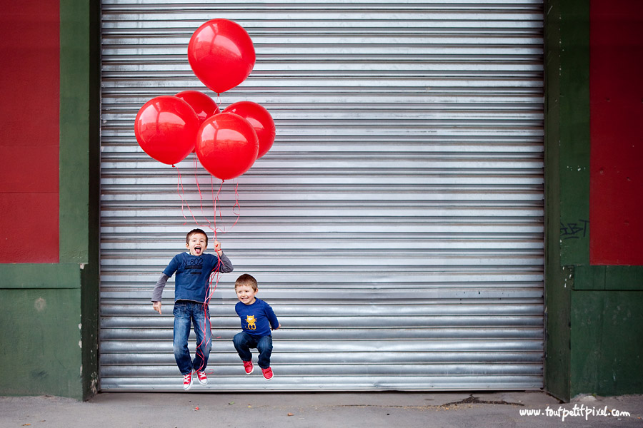 boys jumping while holding red balloons picture by Lisa Tichane of Tout Petit Pixel