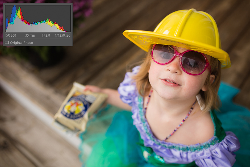 toddler in a hard hat and sunglasses by Kristy Dooley
