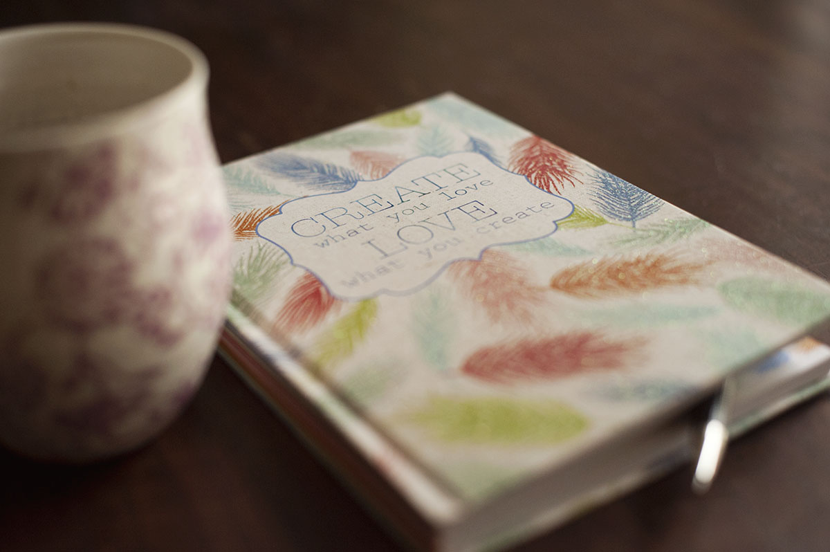 Art journal with a cup of coffee photo by Jodi Arego