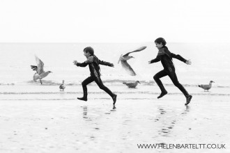 boys running on beach with birds picture by Helen Bartlett