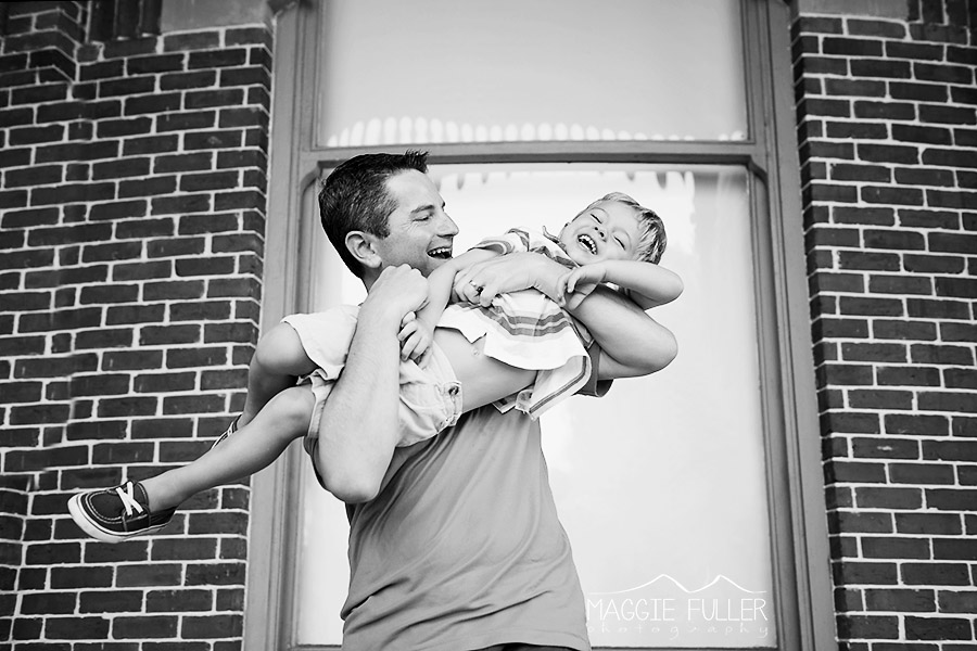 father tickling son photo by Maggie Fuller