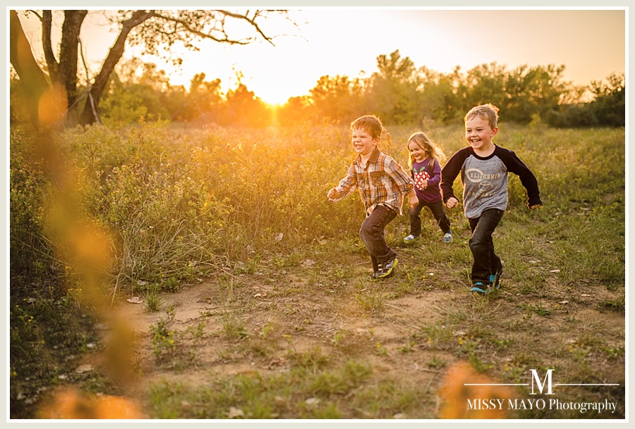 kids running in a field and laughing photo by Missy Mayo