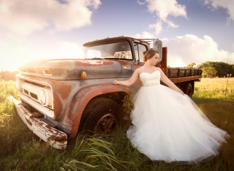wedding portrait by an old rusted truck by Kate Luber