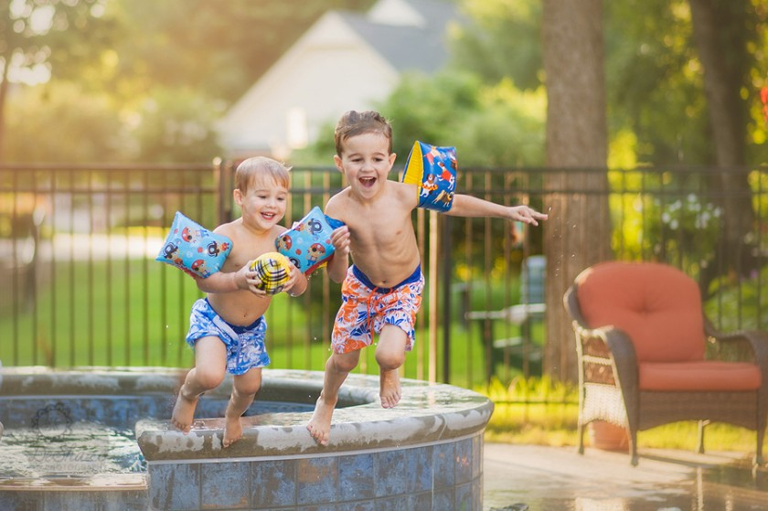 boys running around the pool by Megan DeShazo