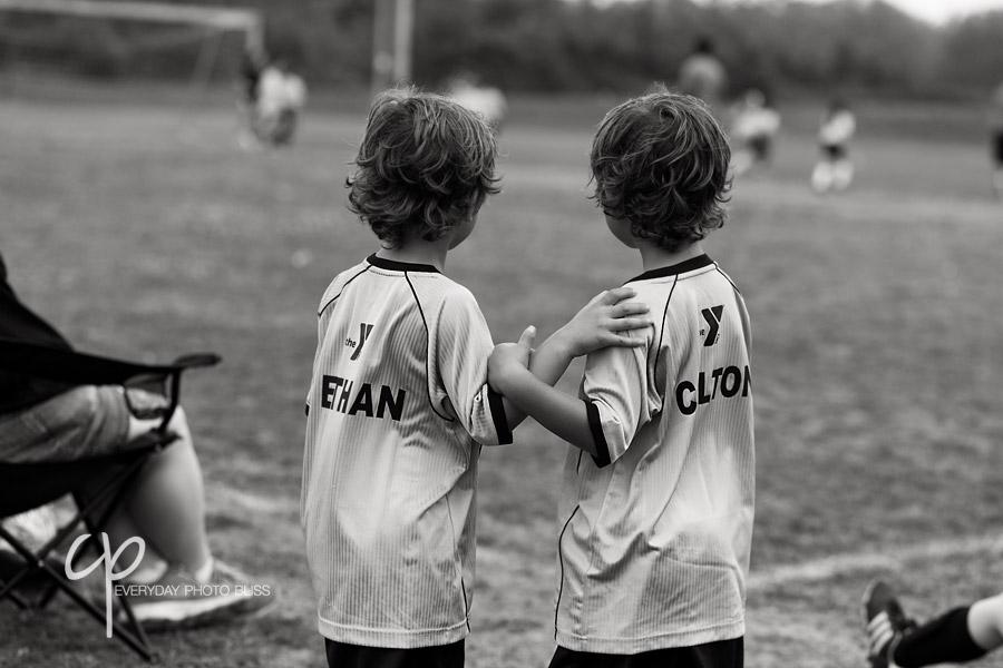 brothers on the soccer field by Celeste Pavlik