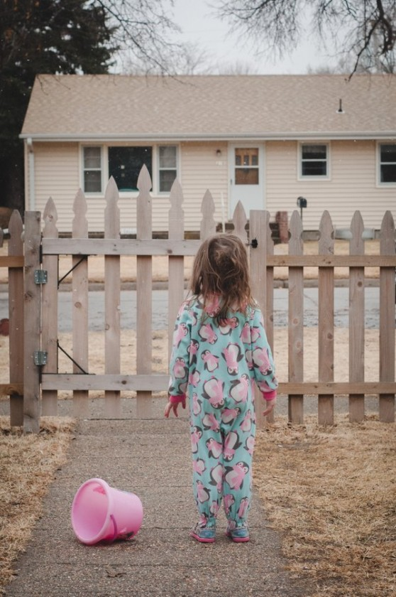 girl-in-pajamas-outside-with-pink-bucket-by-clara-williams