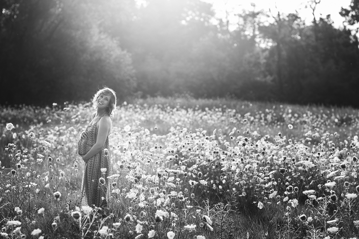 maternity portrait in black and white in a field by Kellie Bieser
