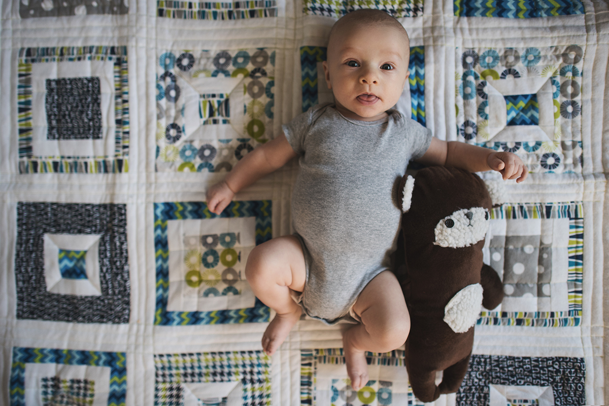 picture of baby with special lovies by Kellie Bieser