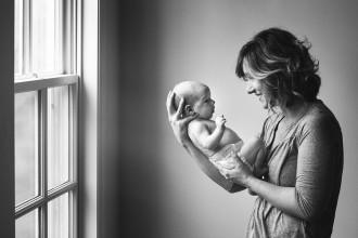 portrait of mom holding newborn by Kellie Bieser