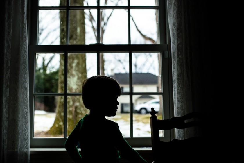silhouette-of-child-at-window-by-andrea-moffatt